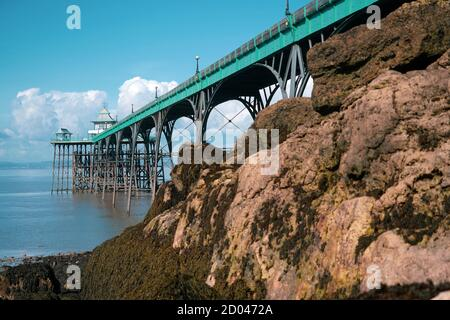Panoramic photo of Clevedon Pier in somerset showing iron structure against blue sky