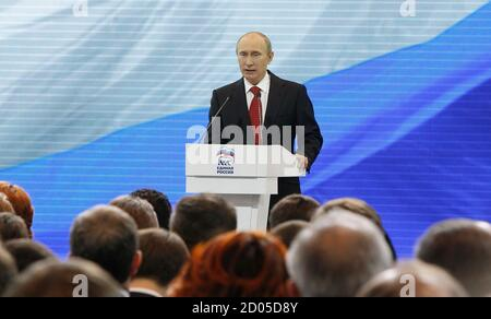 Russia's President Vladimir Putin addresses the audience during a United Russia party congress in Moscow May 26, 2012.   REUTERS/Maxim Shemetov (RUSSIA  - Tags: POLITICS) - Stock Photo