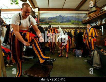 Former Swiss Guards put on their uniforms before their bi-annual General Assembly in Lausanne August 31, 2013. The Association of Former Swiss Guards was founded in 1921 and currently has around 1000 members that meet up once every two years for a meeting at a Swiss city. The Swiss Guard, which was founded in 1506, consists of 100 volunteers who must be Swiss nationals, Catholic, single, at least 174 cm (5.7 ft) tall and beardless. New recruits are sworn in every year on May 6, commemorating the date on which 147 Swiss soldiers died defending the Pope during an attack on Rome on May 6, 1527. R - Stock Photo