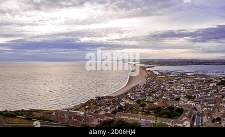 Beautiful hight view for cityscape on Isle of Portland in Unided Kingdom, photo showing a narrow shoreline leading to UK mainland, surrounding ocean