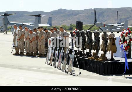 A moment of silence is given to marines from the 3rd Marine Aircraft Wing, who lost their lives in the crash of their military helicopter while coming to the aid of earthquake victims in Nepal, during a memorial service at Camp Pendleton, California June 3, 2015. REUTERS/Mike Blake Stock Photo