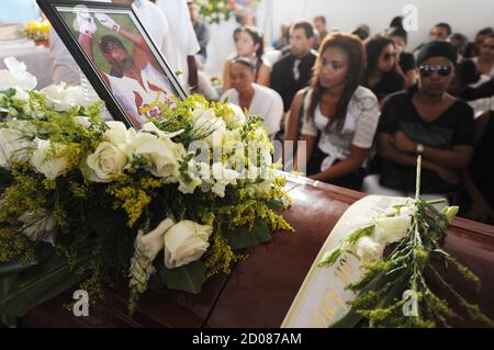 Family and friends of St. Louis Cardinals' outfielder Oscar Taveras attend his funeral in the town of Sosua, Puerto Plata province, October 28, 2014. Taveras, 22, was killed Sunday night along with Yamaly Arvelo, 18, while driving a 2014 Chevrolet Camaro on the tourist road Sosua-Puerto Plata on the north coast of Dominican Republic, police said. St. Louis Cardinals manager Mike Matheny on Monday called the death of Oscar Taveras, a top prospect killed in a car accident, 'a horrible loss of a life.'  REUTERS/Ricardo Rojas (DOMINICAN REPUBLIC - Tags: SPORT BASEBALL OBITUARY)