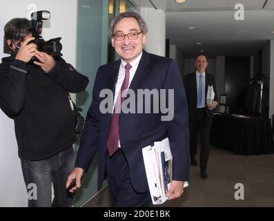 Michael Sabia, president and chief executive officer of Caisse de depot et placement du Quebec (CDP) walks to a press briefing for the release of their 2013 financial results in Montreal, February 26, 2014. REUTERS/Christinne Muschi (CANADA - Tags: BUSINESS)