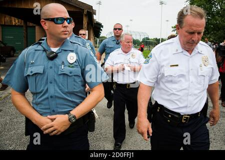 Ferguson Police Chief Thomas Jackson (C) walks away from a media availability regarding his office's handling of the release of information following the shooting of Michael Brown in Ferguson, Missouri August 15, 2014. Picture taken August 15, 2014. REUTERS/Lucas Jackson (UNITED STATES - Tags: CIVIL UNREST CRIME LAW POLITICS)