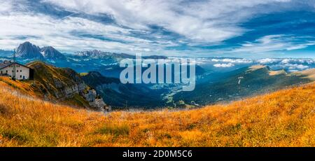 Landscape on the Gardena Valley from Seceda in autumn season with cloudy sky, Alto Adige - Stock Photo