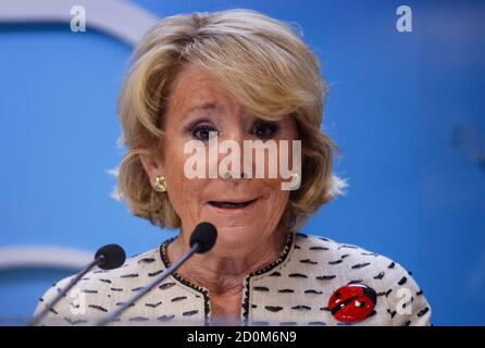 Esperanza Aguirre, former Madrid regional president and current president of the Madrid branch of the conservative Popular Party,  speaks during a news conference in Madrid, April 8, 2014. Aguirre was fined by traffic police last Thursday for parking illegally in a bus lane in Madrid's Gran Via thoroughfare while withdrawing money from an ATM, and subsequently fleeing the scene and knocking over a police motorcycle while an officer was issuing a ticket.  REUTERS/Andrea Comas (SPAIN - Tags: POLITICS CRIME LAW) - Stock Photo