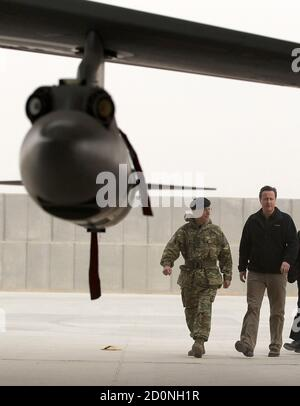 Britain's Prime Minister David Cameron views a Tornado fighter jet based with 12 (B) squadron at Kandahar airfield during a visit to meet British forces in Afghanistan December 20, 2011.   REUTERS/Jeff J Mitchell/Pool      (AFGHANISTAN - Tags: MILITARY POLITICS CONFLICT)