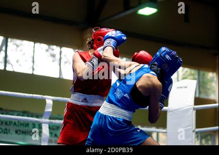 KHARKIV, UKRAINE - OCTOBER 2, 2020: Girls boxers in the fight on the ring during the Ukraine Women Champion Cup 2020