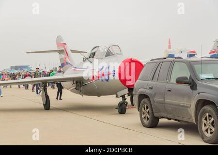 ZHUKOVSKY, MOSCOW REGION, RUSSIA - AUGUST 31, 2019: a car tows an fighter aircraft to the runway - Stock Photo