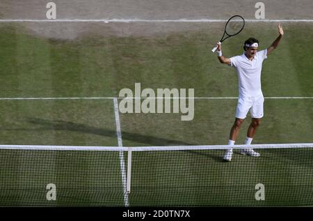 Roger Federer of Switzerland reacts after defeating Milos Raonic of Canada in their men's singles semi-final tennis match at the Wimbledon Tennis Championships, in London July 4, 2014.              REUTERS/John Walton/Pool   (BRITAIN  - Tags: SPORT TENNIS) - Stock Photo