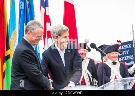 Boston, Massachusetts. 13th June, 2017. Former US Secretary of State, John Kerry, shaking hands with Governor Charlie Baker at Sail Boston ceremonies. - Stock Photo