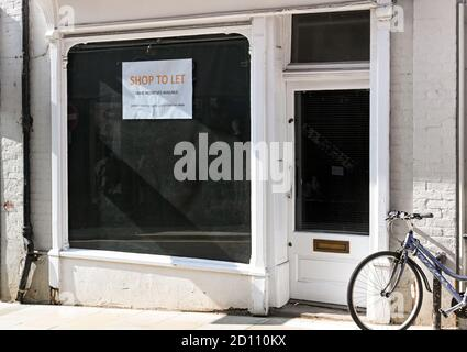 Monmouth, Wales - September 2020:  Sign in the window of an empty shop advertising the premises to let. - Stock Photo
