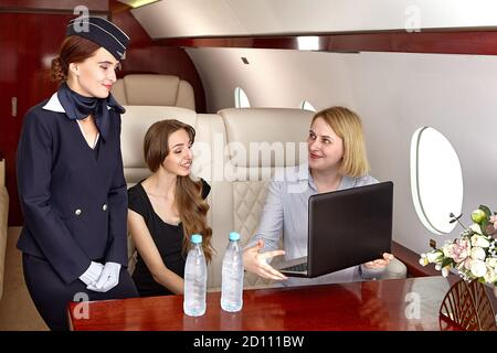 Cabin crew serves passengers inside the aircraft. A flight attendant or air hostess, is a member of the aircrew aboard commercial flights and business