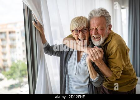 Cheerful senior couple enjoying life and spending time together - Stock Photo