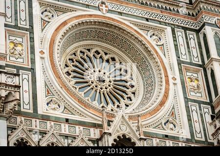 Florence Cathedral, Duomo of Santa Maria del Fiore, closeup of the Main Facade with the Rose Window. UNESCO world heritage site, Tuscany, Italy. Stock Photo