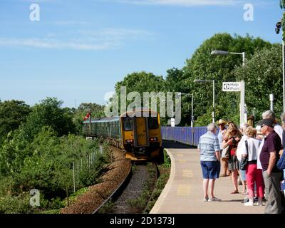 A train departs from Lelant Saltings on the St Ives to St Erth branchline, Cornwall. - Stock Photo