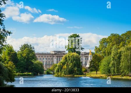 UK, London, Westminster. The facade of Buckingham Palace and St James's Park and lake