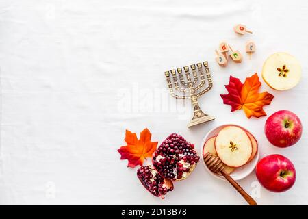 Jewish cuisine for rosh hashana holiday - apple honey and pomegranate, top view