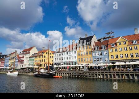 Nyhavn basin with typical colored houses in Copenhagen, Denmark on sunny day