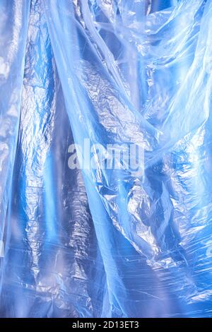 Abstract blue background of colorful textured holographic polyethylene
