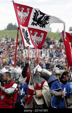 Amateur actors take part during a re-enactment of the battle at Grunwald, which took place 1410 between Teutonic order knights and Polish and Lithuanian knights, in Grunwald, north Poland July 15, 2006. REUTERS/Katarina Stoltz (POLAND) - Stock Photo