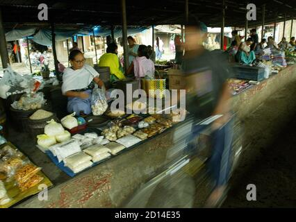 - PHOTO TAKEN 17AUG05 - An Indian boy cycles in front of street vendors at a market in Imphal, the capital of the northeastern Indian state of Manipur, August 17, 2005. [Nearly five years ago, human rights activist Irom Sharmila went on a hunger strike in the remote Indian state of Manipur. Appalled by the shooting of 10 people by the army at a rural bus stop in November, 2000, she said she would fast until the government repealed a law that gives soldiers sweeping powers to kill suspects, with virtual immunity from prosecution. Ironically, in the country where Mahatma Gandhi made fasting such