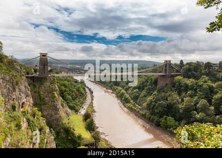 BRISTOL CITY CENTRE ENGLAND BRUNELS CLIFTON SUSPENSION BRIDGE OVER THE AVON GORGE AND A ROCK CLIMBER NEAR THE YELLOW VIEWING PLATFORM