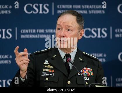 General Keith Alexander, Director of the NSA and Commander of U.S. Cyber Command speaks about cyber security and USCYBERCOM at the Center for Strategic and International Studies (CSIS) in Washington, June 3, 2010. REUTERS/Hyungwon Kang   (UNITED STATES - Tags: MILITARY POLITICS SCI TECH) - Stock Photo