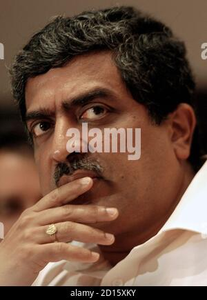Nandan M. Nilekani, president, chief executive officer and managing director of Infosys Technologies, watches during the results for the quarter at the Infosys campus in southern Indian city of Bangalore October 11, 2006. Infosys Technologies Ltd., India's second-largest software exporter, beat market estimates with a sharp rise in quarterly profit on Wednesday and raised revenue and earnings forecasts, sending its shares as much 6.2 percent higher. REUTERS/Jagadeesh Nv (INDIA)