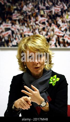 Esperanza Aguirre, Madrid Regional President, gestures during a her Popular Party's regional executive board meeting at the party's headquarters in Madrid February 11, 2009. High Court magistrate Baltasar Garzon named 34 people on February 10, 2009 as suspects in an investigation into corruption in the Popular Party, taking the total number of suspects to 37. The corruption investigation comes on the tail of allegations of in-party spying in the Popular Party Madrid regional government.  REUTERS/Sergio Perez  (SPAIN)
