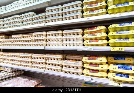 Samara, Russia - November 24, 2019: Different fresh chicken eggs in boxes ready for sale on the shelves at the grocery store
