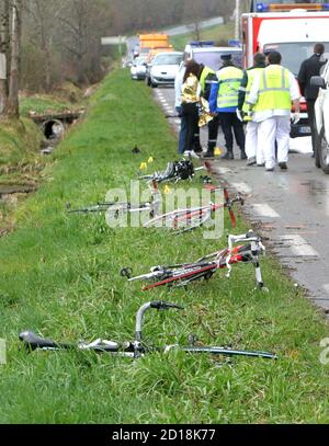 Emergency services gather at the scene of an accident where a car hit a group of 10 cyclists in Villecomtal sur Arros in southwestern France March 8, 2009. At least one cyclist was killed and the others injured in the accident.    REUTERS/Laurent Dard  (FRANCE DISASTER) - Stock Photo