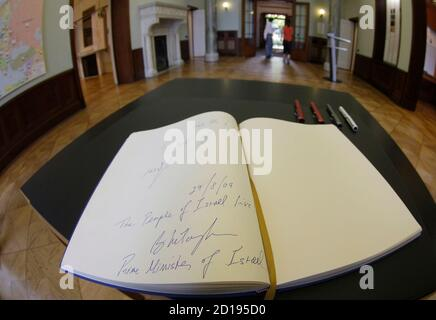 The signature of Israel's Prime Minister Benjamin Netanyahu and his wife Sara are pictured in the guestbook after visiting the memorial site of the House of the Wannsee Conference in Berlin, August 27, 2009. On January 20, 1942, a group of 15 high-ranking Nazis chaired by Reinhard Heydrich, the Reichsprotektor of Bohemia and Moravia, met at the villa where they discussed the bureaucratic details of killing Europe's Jews. The villa where the meeting took place is now a museum.     REUTERS/Tobias Schwarz     (GERMANY)
