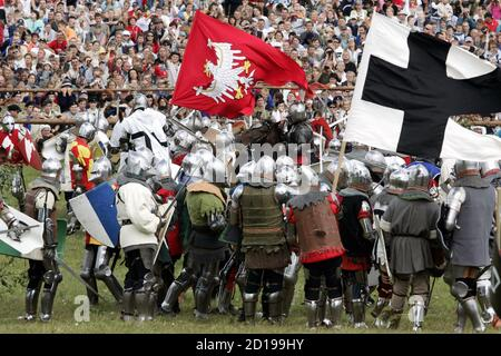 Amateur actors fight during a re-enactment of the battle at Grunwald, which took place in 1410 between Teutonic order knights and Polish and Lithuanian knights, in Grunwald, north Poland July 15, 2006. REUTERS/Katarina Stoltz (POLAND) - Stock Photo