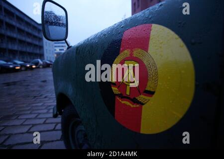 An East German Trabant car painted in the military colours of former East German National People's Army (NVA) is pictured during a guided tourist tour through the streets of Berlin,  November 4, 2009. A Berlin company is offering driving in a Trabant car in a guided tour called 'The Wall Ride 20 Jahre Mauerfall' taking in historical landmarks in the German capital.     REUTERS/Tobias Schwarz     (GERMANY TRANSPORT ANNIVERSARY SOCIETY) - Stock Photo