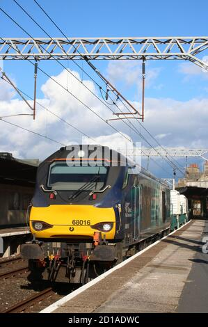 Direct Rail Services (DRS) class 68 diesel-electric locomotive 68016 Fearless at Carnforth station on Monday 5th October 2020 on nuclear flask train. - Stock Photo