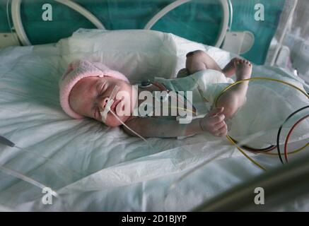 A three-month-old baby named Laura receives milk through a probe inside an incubator at Son Dureta's Hospital in Palma de Mallorca, Spain March 10, 2006.  The first and only Donor milk bank in Spain is on the Balearic island of Mallorca at the 'Fundacion Banco de Sangre y Tejidos de les Illes Balears'. The bank provides milk to premature babies under 1.5kg of weight in neonatal intensive care units. - Stock Photo