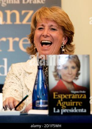 President of Madrid's regional government Esperanza Aguirre laughs during the presentation of her biography 'Esperanza Aguirre La Presidenta' in Madrid November 28, 2006.  REUTERS/Andrea Comas  (SPAIN) Stock Photo