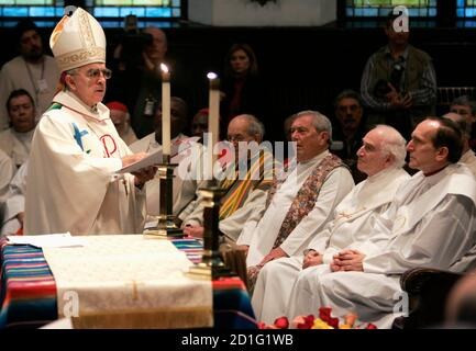 Archbishop Patrick Tujillo (L) reads at an ordination for married deacons Dominic Riccio (2nd R) and Raymond Grosswirth (R) presided over by excommunicated Roman Catholic Archbishop Emmanuel Milingo (not pictured) at the Trinity Reformed Church in West New York, New Jersey, December 10, 2006. Trujillo was ordained several years ago by Milingo, the founder of 'Married Priests Now!', a group pressuring the Vatican to make priest celibacy optional. Milingo ordained the two married clergymen, Riccio and Grosswirth, as priests on Sunday, defying the Vatican over the controversial issue of celibacy  - Stock Photo