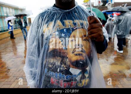 A man wears a Dr. Martin Luther King T-shirt beneath his poncho as he waits in the rain outside Lorraine Motel, now part of the National Civil Rights Museum, where Rev. Dr. Martin Luther King Jr. was assassinated in 1968 in Memphis, April 4, 2008. April 4th marks the 40th anniversary of the assassination of the civil rights leader who was shot as he stood on the balcony of Lorraine Motel. REUTERS/Mike Segar   (UNITED STATES)