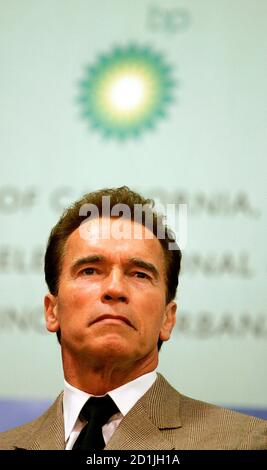 California Governor Arnold Schwarzenegger sits during a press conference in Berkeley, California February 1, 2007. British oil major BP Plc on Thursday announced that universities in California and Illinois will join company scientists in a $500 million energy research program focused on cleaner, alternative fuels.  REUTERS/Kimberly White (UNITED STATES) - Stock Photo