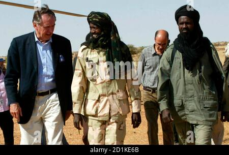 Special envoy to Darfur Jan Eliasson meets the SLM Unity leader Abdallah Yahya (C) in Beradik town, north of El Fasher in northern Darfur, December 6, 2007. Delays in deploying a joint U.N.-African Union force in Darfur are undermining efforts to negotiate a peace agreement for the Sudanese region, the U.N's mediator Eliasson said earlier. Picture taken December 6, 2007. REUTERS/Mohamed Nureldin Abdalla (SUDAN)