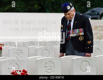 Canadian Second World War veteran Leonard Decosse views gravestones at a Canadian military cemetery in Dieppe August 18, 2007. Sixty-five years ago Canadian forces, supported by British commandos and American Rangers, launched a raid August 19, 1942 on the German-occupied French coast around Dieppe at a cost of over 900 men. Of the 4,963 Canadians who embarked for the operation, only 2,210 returned to England and many of these were wounded. It was the first Allied assault on mainland Europe of the Second World War.  REUTERS/Chris Helgren    (FRANCE) - Stock Photo