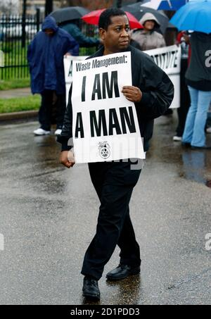 A member of the Memphis Tennessee 'Beloved Community' carries a sign as he marches to the former Lorraine Motel, now part of the National Civil Rights Museum, where Rev. Dr. Martin Luther King Jr. was assassinated in 1968 in Memphis, April 4, 2008. April 4 marks the 40th anniversary of the assassination of the civil rights leader shot as he stood on the balcony of the Lorraine Motel. REUTERS/Mike Segar   (UNITED STATES)