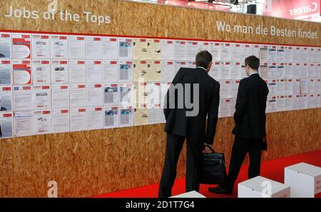 Visitors look at a wall with job offers at the 'Hannover Messe' industrial trade fair in Hanover April 22, 2008. About 100,000 open jobs for engineers and technicians are available in Germany, the Association of German Engineers VDI said in a news conference on Monday. The world's leading fair for industrial technology, with about 5,100 exhibitors from 62 nations, opened to the public on Monday and runs till April 25 with Japan as this year's partner country.  REUTERS/Christian Charisius  (GERMANY)