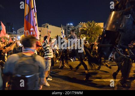 2.10.2020 Tel Aviv, Israel. Protest against Prime minister Netanyahu and second Coronavirus lockdown. Police horses were used to block the protestors from crossing LaGardia street in Tel Aviv, and were guided to use force while pushing the protestors by police horseman