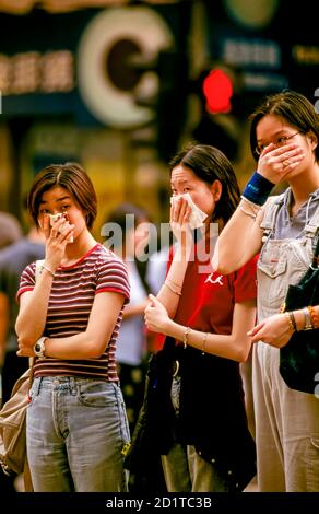 People trying to breath in polluted air without face masks, Hong Kong, SAR, China - Stock Photo