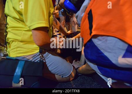 2.10.2020 Tel Aviv, Israel. Protest against Prime minister Netanyahu and second Coronavirus lockdown.An injured protestor who was run over by a police horse is getting medical treatment in the police detention coral on LaGardia street in Tel Aviv.