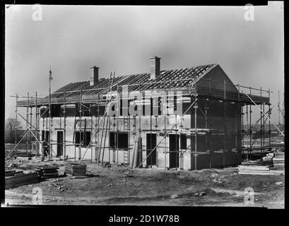 A pair of semi-detached Easiform houses under construction on the Penhill Estate, Penhill, Swindon, Wiltshire, UK. - Stock Photo