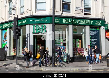 London, UK, April 1, 2012 : Holland & Barrett logo advertising sign outside its business retail store which sells health benefit products and a stock